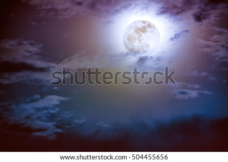 Attractive photo of background nighttime sky with cloud and bright full moon with shiny. Nightly sky with beautiful full moon. Outdoors at night. The moon were NOT furnished by NASA.