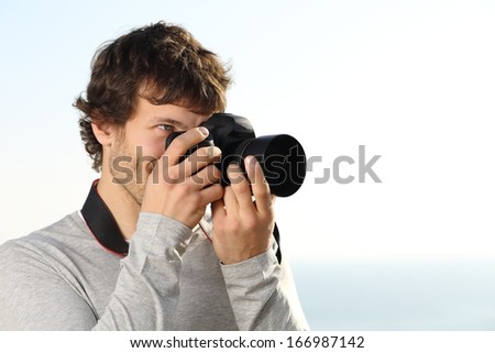 Attractive photograph photographing with a slr camera outdoor with the sky in the background          - stock photo