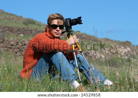 Attractive photographer with camera - stock photo
