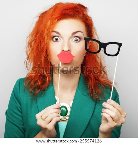Attractive playful young woman ready for party - false lips and glasses    - stock photo