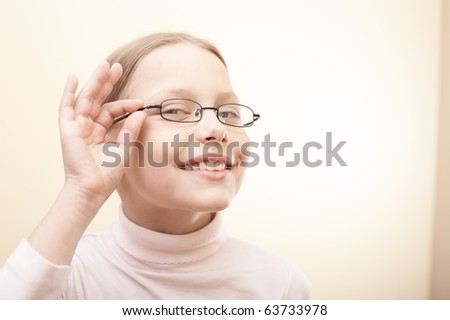 Attractive portrait of cute little girl in glasses - stock photo