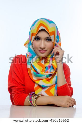 Attractive portrait of young muslim woman sitting while thinking, ideas