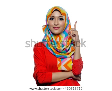 Attractive portrait of young muslim woman while thinking, ideas - stock photo