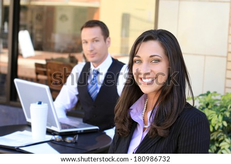 Attractive Professional Business Professional Team Business Man and Business Woman Working on a Project Businessman and Businesswoman - stock photo