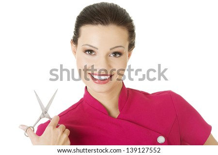 Attractive professional hairdresser woman with scissors - stock photo
