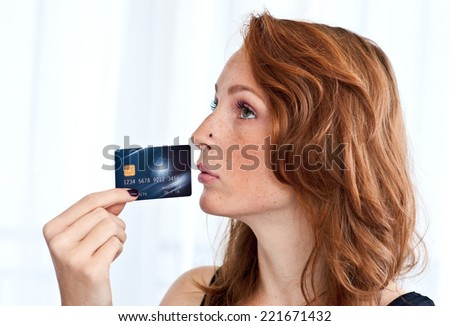 attractive red hair freckles woman with credit card