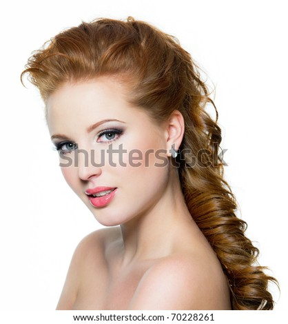 Attractive red-haired female with beautiful face, posing isolated on white