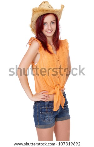 Attractive redhead girl in orange shirt and straw hat, summer portrait, isolated