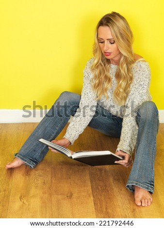 Attractive Relaxed Young Woman Reading a Book - stock photo