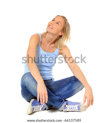 Attractive scandinavian girl sitting on floor. All on white background. - stock photo