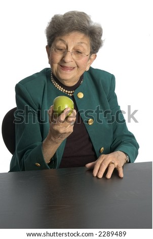 attractive senior citizen about to eat an apple