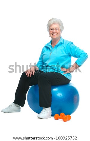 Attractive senior woman at health club, doing exercises - stock photo