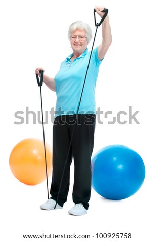 Attractive senior woman at health club, doing exercises with a chest expander