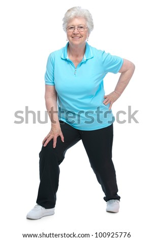 Attractive senior woman at health club, doing  stretching exercises - stock photo