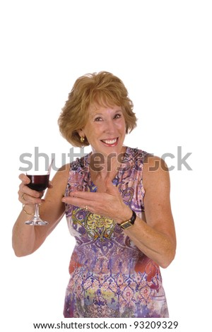 Attractive senior woman drinking wine on a white background - stock photo
