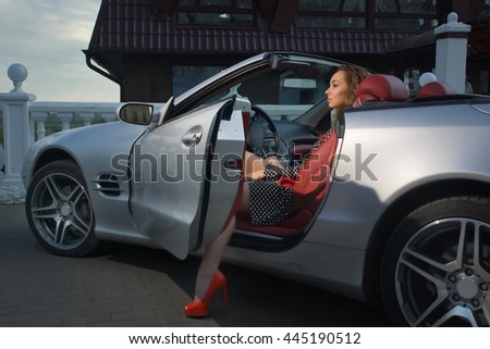 Attractive sensual fashionable woman in a car - stock photo