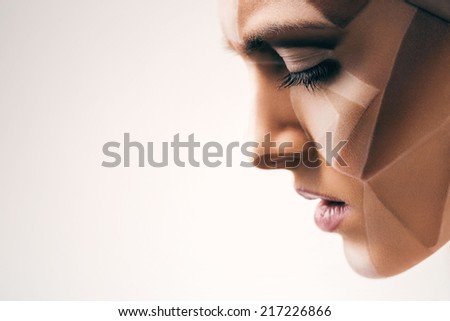 attractive sensual woman with bodyart on face - stock photo