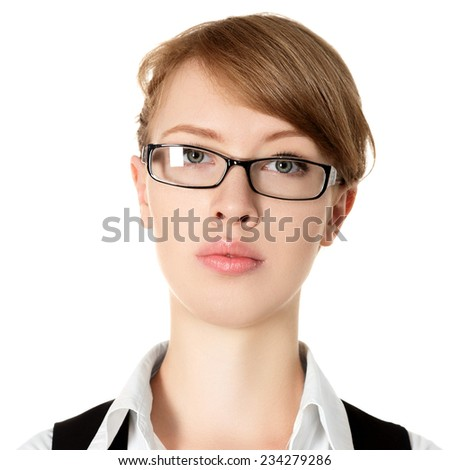 Attractive serious young businesswoman isolated on white background