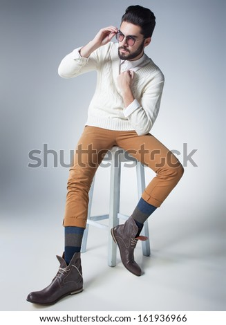 attractive sexy man dressed casual looking serious posing dramatic - stock photo