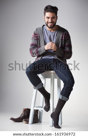 attractive sexy man dressed casual smiling in the studio - stock photo