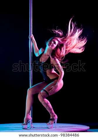 attractive sexy woman pole dancer performing - stock photo