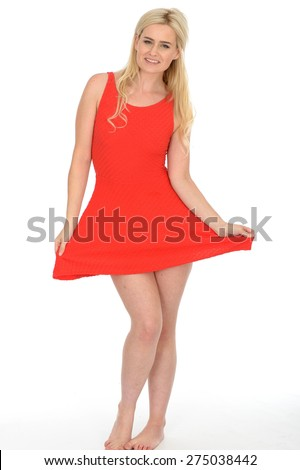 Attractive Sexy Young Blonde Haired Woman in Her Twenties Wearing a Short Red Mini Dress in Bare Feet - stock photo