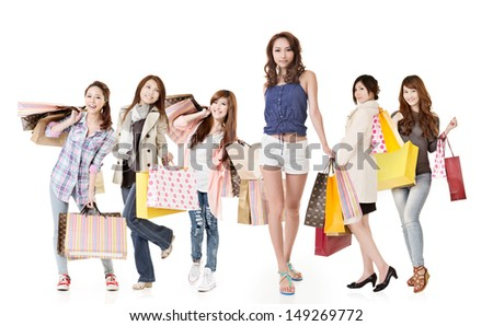 Attractive shopping women walk and look at you, group full length portrait isolated on white background. - stock photo