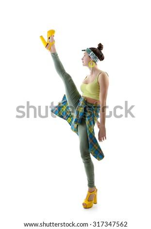 Attractive slim teen girl posing in studio. Full length portrait of young fashion woman. Fitness dancing girl. Steps like splits. - stock photo
