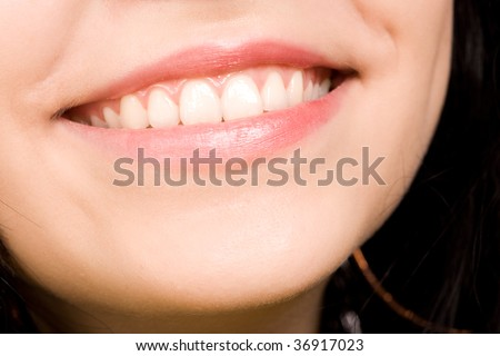 attractive smile of the beautiful young woman - stock photo