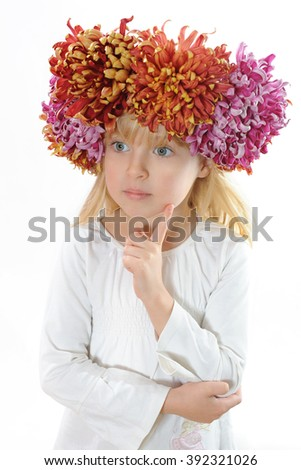 Attractive smiling blonde girl wearing flower wreath isolated on white background - stock photo
