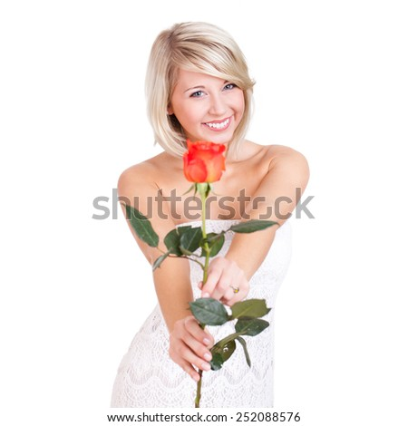attractive smiling blonde woman with a rose on white background - stock photo