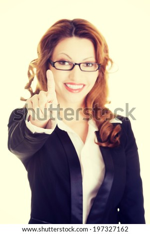 Attractive smiling businesswoman making choose on abstract screen