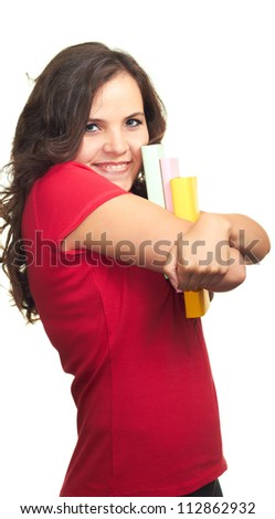 Attractive smiling girl in a red shirt hugs colorful book. Isolated on white background