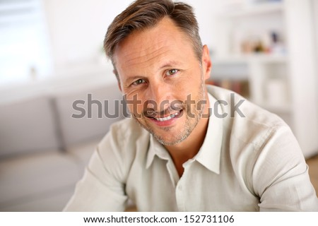 Attractive smiling man relaxing at home - stock photo