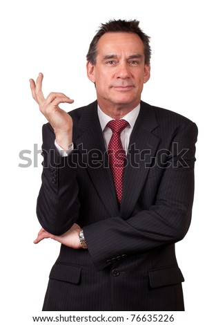 Attractive Smiling Middle Age Business Man in Suit Gesturing with Hand - stock photo