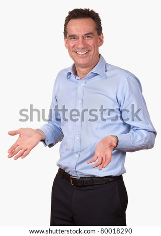 Attractive Smiling Middle Age Man in Blue Shirt with Open Hands