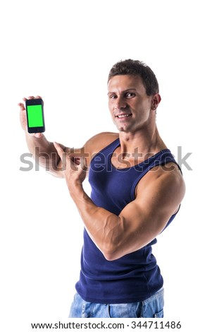 Attractive smiling muscular young man showing his cell phone's blank green screen, isolated on white - stock photo