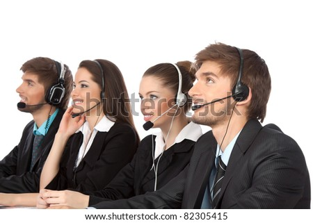 Attractive Smiling positive young businesspeople and colleagues in a call center office, support phone operators with headset at workplace isolated over white background, agent friendly looking - stock photo