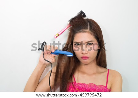 attractive smiling woman brushing her hair t on white background