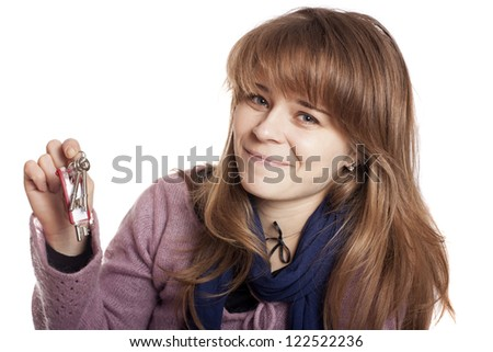 Attractive smiling woman holding up a set of keys isolated on white - stock photo