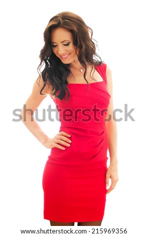 Attractive smiling woman in red dress. Isolated on white.