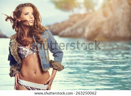 attractive smiling woman portrait on beach - stock photo