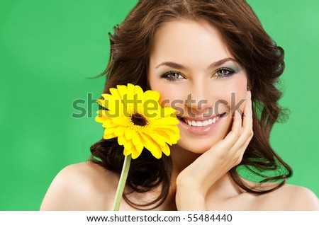 attractive smiling woman portrait on green background - stock photo