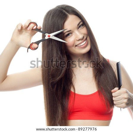 attractive smiling woman portrait with comb and scissors on white background