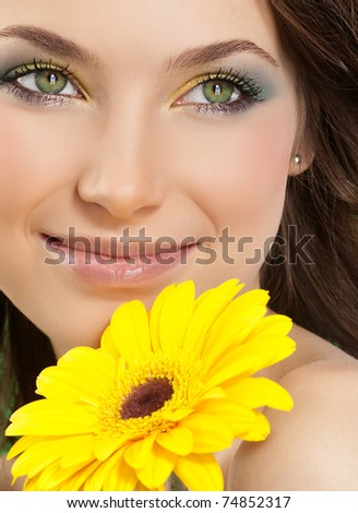 attractive smiling woman portrait with flower - stock photo