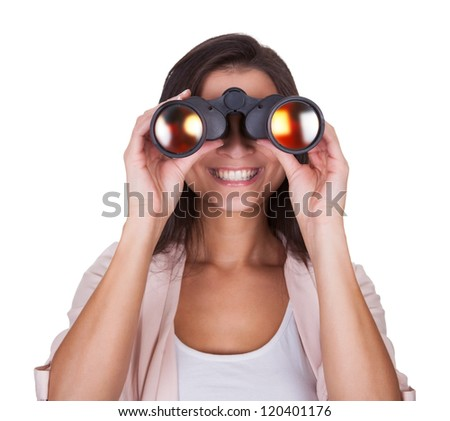 Attractive smiling woman with binoculars isolated on white - stock photo