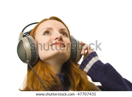 Attractive smiling woman with headphones. Isolated - stock photo
