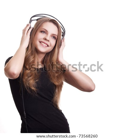attractive smiling woman with headphones on white background - stock photo