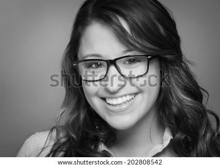 Attractive smiling young woman black and white headshot - stock photo