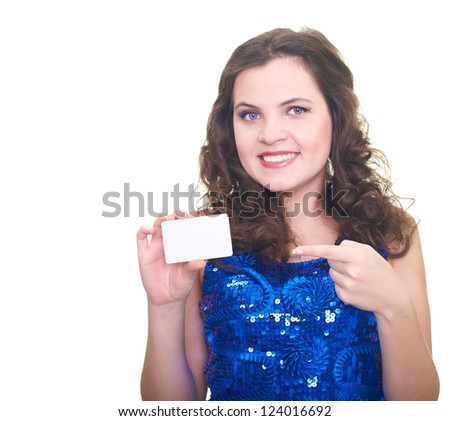 Attractive smiling young woman in a blue brilliant dress holding in her right hand a poster, and her left hand pointing to it. Isolated on white background